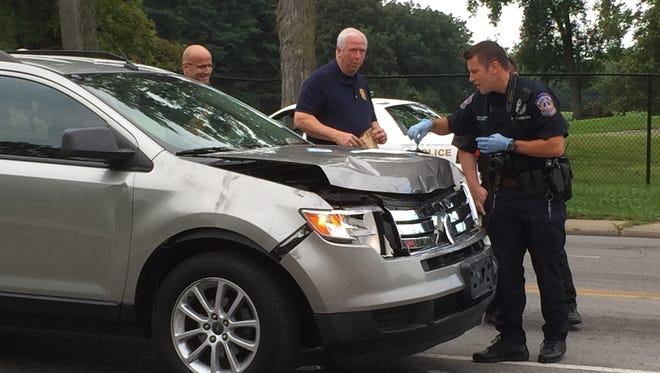 IMPD officers gather evidence from the vehicle suspected in multiple hit-and-runs at 30th Street and Cold Spring Road in Downtown Indianapolis Wednesday, Aug. 26.