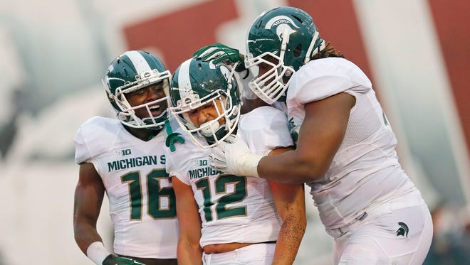 Michigan State wide receiver Aaron Burbridge (16), celebrates after Michigan State Spartans wide receiver R.J. Shelton (12) scored a touchdown in the second half against Indiana.