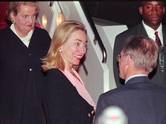 Hillary Clinton arrives at the Beijing airport on Sept.