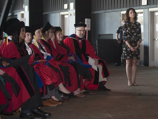 Kimberly Williams waits to receive a diploma for her