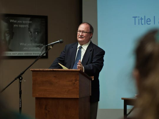 Dale Thomas, Jackson-Madison County School Board lawyer, speaks to the school board about following federal regulations and state authority of Title I.