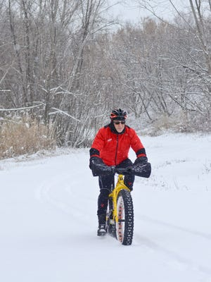 Jamie Rosenberg rides his bike on a section of the Fox River Trail in Allouez.