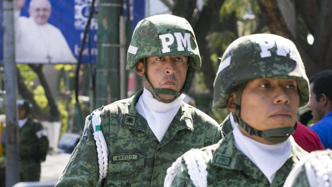 Mexican military stand guard near where Pope Francis is staying at the Vatican diplomatic mission in Mexico City, Mexico, on Friday, February 12, 2016.
