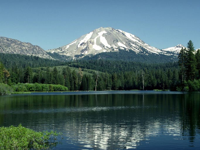 Manzanita Lake shows the reflection of a hikeable volcano in the Lassen Volcanic National Park.