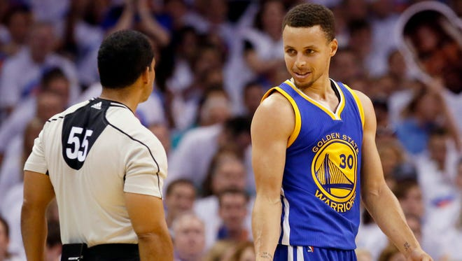 Golden State Warriors guard Stephen Curry talks with referee Bill Kennedy during the first half.