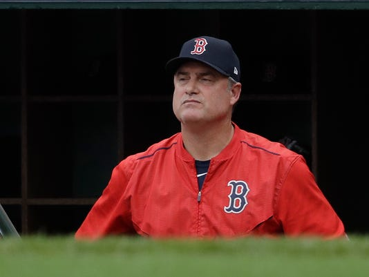 FILE - In this Oct. 8, 2017, file photo, Boston Red Sox manager John Farrell watches from the dugout during the second inning in Game 3 of baseball's American League Division Series against the Houston Astros, in Boston. The Red Sox announced Wednesday, Oct. 11, 2017, that Farrell will not return as the club's manager for the 2018 season. President of Baseball Operations Dave Dombrowski made the announcement. (AP Photo/Charles Krupa, File)