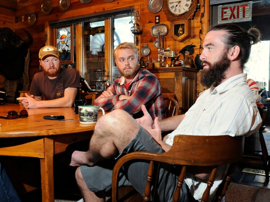 Trigg, (left to right) Flynn and Delano discuss how the route evolved and why they tacked on another 2,200 miles to make the trip more challenging.