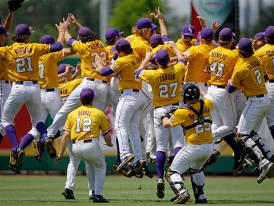 LSU players leap in the outfield after defeating UNC Wilmington at the Baton Rouge Regional of the NCAA college baseball tournament in Baton Rouge Monday.