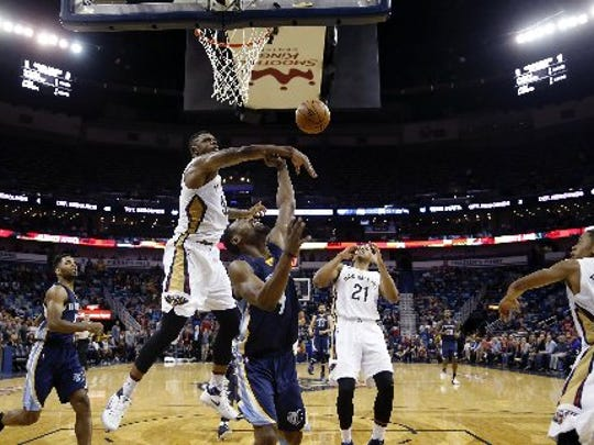 New Orleans Pelicans forward Terrence Jones (9) tries to block a shot by Memphis Grizzlies guard Tony Allen (9) during overtime of an NBA basketball game in New Orleans, Monday, Dec. 5, 2016. The Grizzlies won in double overtime 110 to 108.
