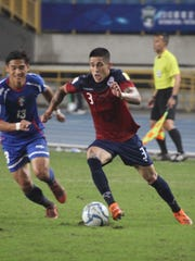 Guam's Jonah Romero looks to advance the ball to the goal against Chinese Taipei during a FIFA international friendly match at the Taipei Municipal Stadium in Taipei. The hosts rallied to edge Guam 3-2 in the contest.
