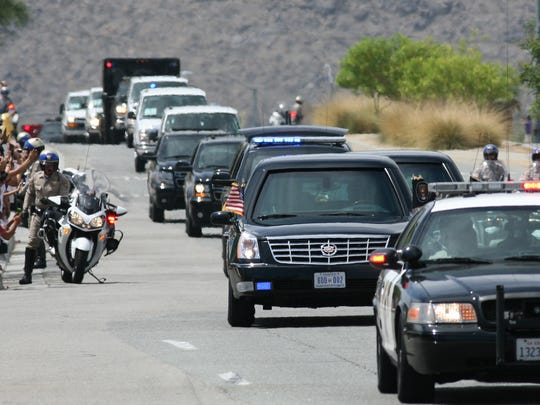 People line south Gene Autry Trail as President Barack Obama's motorcade arrives at  Palm Springs International Airport Sunday, June 9, 2013 following 2 days of meetings with Chinese President Xi Jinping at Sunnylands in Rancho Mirage CA. Michael Snyder/The Desert Sun