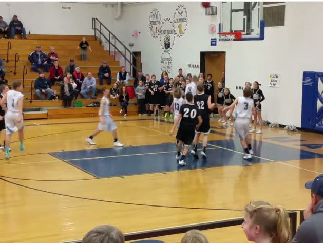 As a recent semi-final basketball game between Kansas middle school rivals Rock Creek Mustangs and Riley County Falcons came to its conclusion, the score was within a hair's breadth of victory for the Falcons.