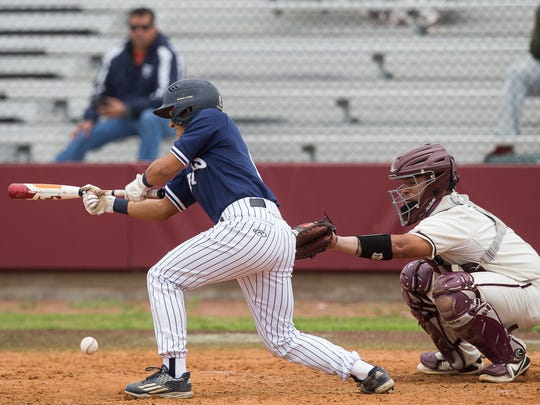 Carroll's Christian Servantes bunts during the first inning of their game against Calallen at Steve Chapman Field on Thursday, March 15, 2018.