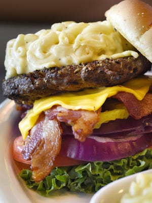 The Mac Attack burger at G-Allen's Restaurant & Sports Bar in Sartell. It's a half-pound beef patty with bacon, cheese, onion, lettuce, tomato and macaroni and cheese on top and on the side.
