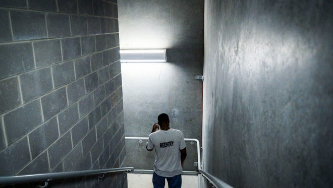 A Lafayette State Parish re-entry program resident heads to the first floor of the facility.