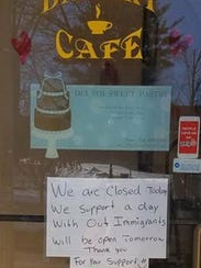 Several signs like this were posted on stores throughout