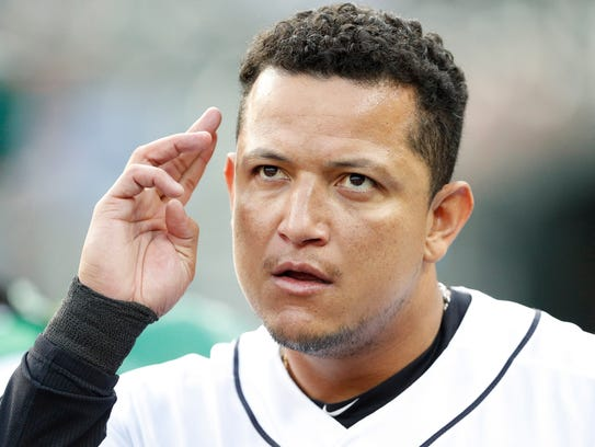 Tigers first baseman Miguel Cabrera (24) wipes his