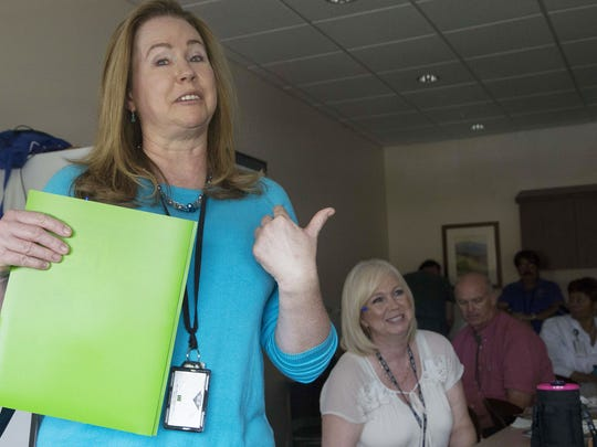 Barbara DuPaul (left) talks about RN Wendy Pourbastani at the VA hospital in Chandler. DuPaul, 51, has spent more than 10 years working for the VA in various locations across the country.