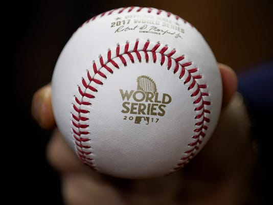 A baseball is seen before Game 5 of baseball's World Series between the Houston Astros and the Los Angeles Dodgers Sunday, Oct. 29, 2017, in Houston. (AP Photo/David J. Phillip)
