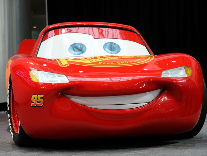 Front view of the Lightning McQueen car at a press