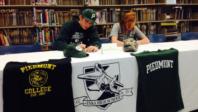 Enka seniors Seth George, left, and Morgan Scholtz have signed with Piedmont (Ga.).