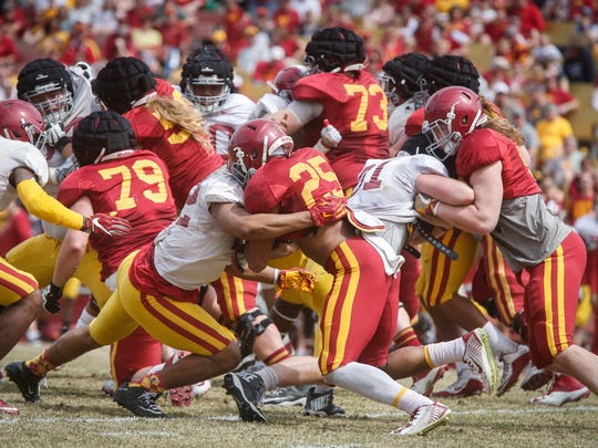 Iowa State sophomore running back Sheldon Croney, Jr., (No. 25) is hit by a member of the Cyclone defense on Saturday, April 8, 2017, during the Iowa State Cyclone football spring game at Jack Trice Stadium in Ames.