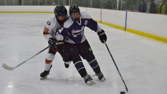 Sean Blaney carries the puck in for John Jay during