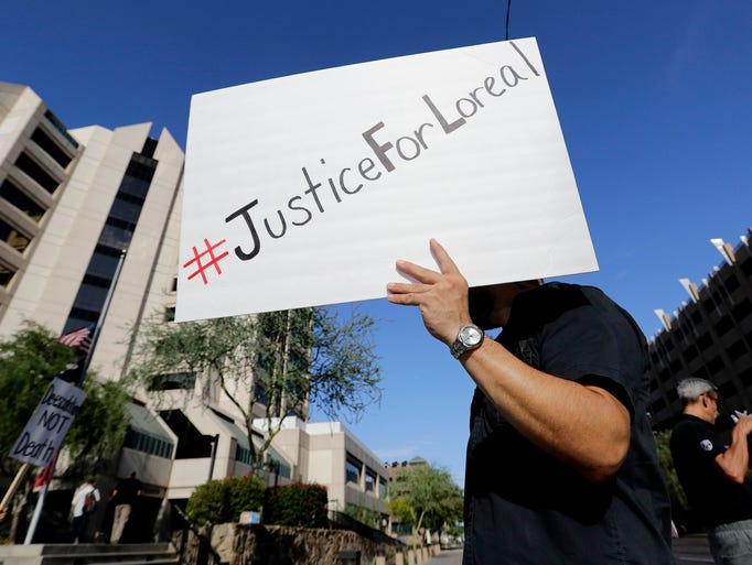 Luke Black protests outside Maricopa County Attorney