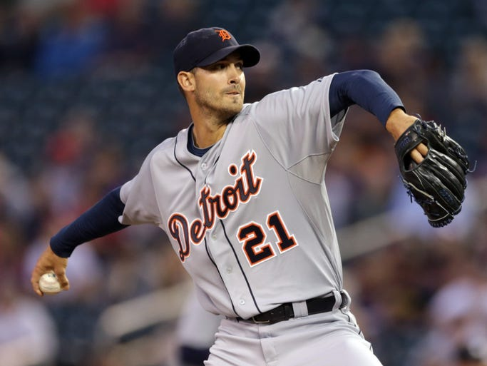 Detroit Tigers pitcher Rick Porcello throws against the Minnesota Twins in the first inning of a baseball game, Tuesday, Sept. 16, 2014, in Minneapolis. The Twins won 4-3.