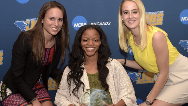 Toni Butler (center) with Georgian Court track teammates Amanda Farina (left) and Jamie Hand (right).
