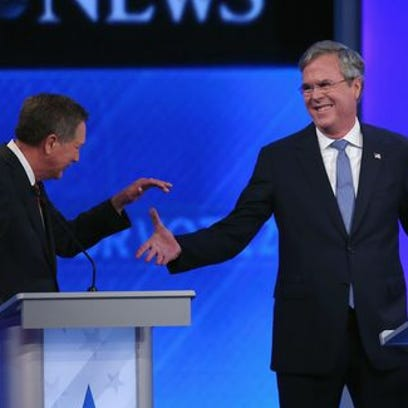 John Kasich and Jeb Bush shake hands during the Republican presidential debate on Feb. 6, 2016 in Manchester, N.H.