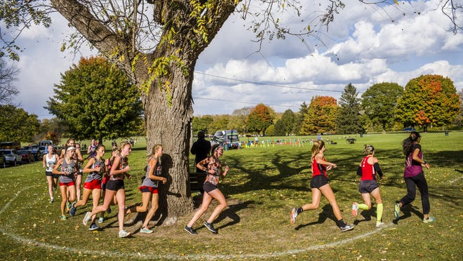 Chicago Latin High School junior Ava Parekh (113), Lincoln Community High School freshman Becca Heitzig (229) and Lakes High School senior Brooke Stromsland (123) lead the pack at the start of the top flight of the Girls Division II race of the Shazam Racing 2020 XC Championships on Saturday, Nov. 7, 2020 at Three Sisters Park in Chillicothe. Parekh went on to win the race with Stromsland in second and Heitzing finishing ninth.