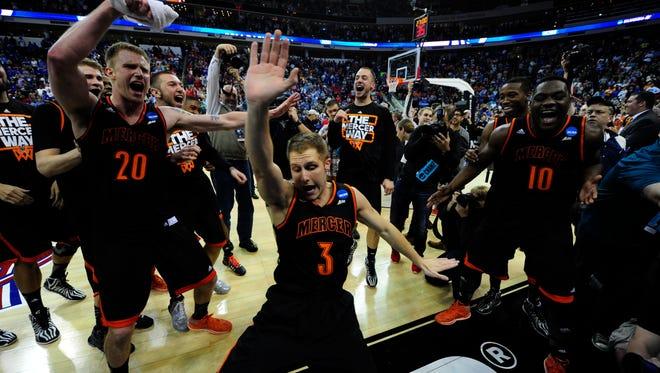 Mercer guard Kevin Canevari dances in celebration.