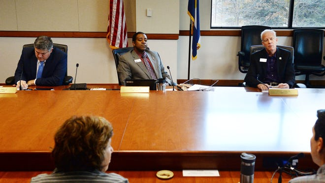 From left, Larimer County Commissioners Tom Donnelly, Lew Gaiter III and Steve Johnson listen during a meeting in October. The commissioners signaled they will support delaying proposed parole reforms.