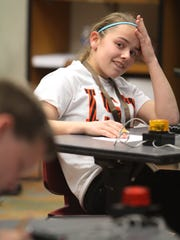 Courtney Skjeveland, 13, of Carmel, Ind., reacts after giving a wrong answer at the National Math Competition for Deaf and Hard-of-Hearing Students held Saturday at the National Technical Institute for the Deaf at RIT.