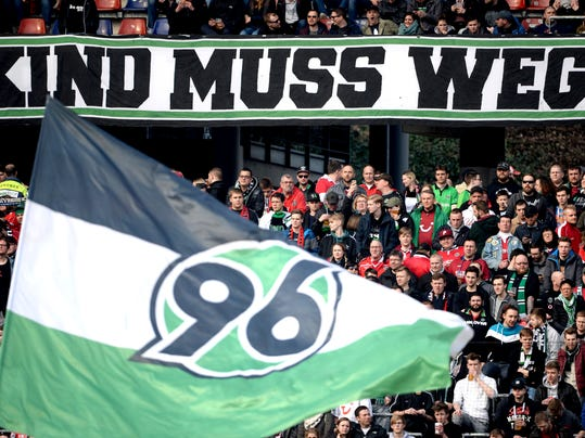 "Banner reads 'Kind must go"" during a match of German first soccer Bundeslga division between Hannover 96 and Augsburg in Hannover, Germany, Saturday, March 10, 2018. (Sven Pfortner/dpa via AP)"