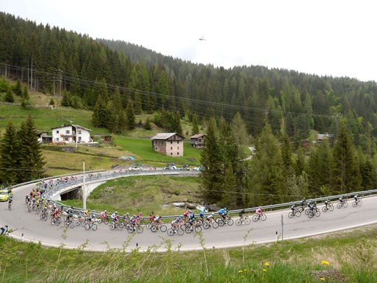 Cyclists pedal during the 18th stage of the Giro d'Italia cycling race, from Belluno to Rifugio Panarotta, Italy, Thursday, May 29, 2014. Julian Arredondo claimed the biggest win of his career with a solo victory on the 18th stage of the Giro d'Italia on Thursday, while Nairo Quintana retained the overall leader's pink jersey as the race returned to the mountains. (AP Photo/Fabio Ferrari)