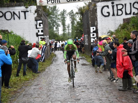 Stage winner Lars Boom of The Netherlands  rides during the fifth stage of the Tour de France cycling race over 155 kilometers (96.3 miles) with start in Ypres, Belgium, and finish in Arenberg, France, Wednesday, July 9, 2014. (AP Photo/Bernard Papon, Pool)