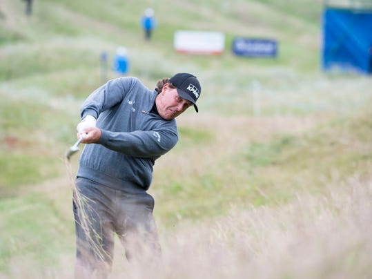 U.S. golfer Phil Mickelson  plays from the rough on the 4th hole during day one of the Scottish Open at Royal Aberdeen golf course, Aberdeen Scotland Thursday July 10, 2014. (AP Photo/Kenny Smith/PA) UNITED KINGDOM OUT