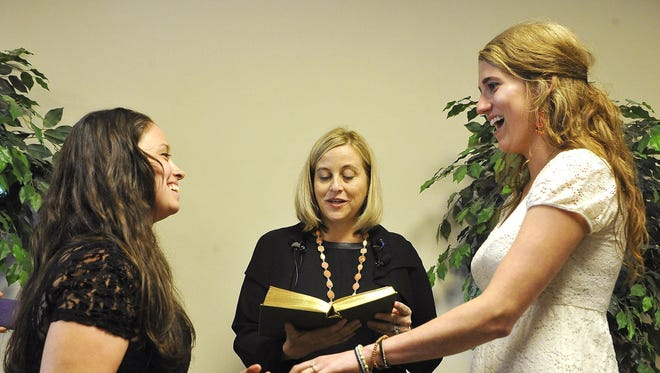 Metro councilwoman and mayoral candidate Megan Barry performed the first same-sex marriage ceremony in Nashville between Lauren Mesnard, 25, and Nikki von Haeger, 26, at the Davidson County Clerk's office.