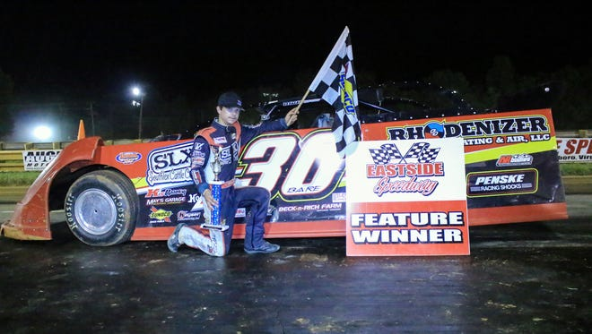 Tyler Bare poses in front of his car in Victory Lane after winning the Late Model feature race at Eastside Speedway in Dooms on Saturday, Sept. 10, 2016.