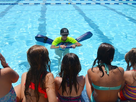 Courtney Pressler with her group of students. Children at the Cocoa Beach Aquatic Center participated in the world's largest swim lesson Thursday morning. Thousands of kids and families at pools, aquatic centers and water parks around the world participated in the mass swim lesson to teach water safety and prevent drowning.
