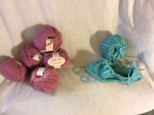On the left, some mauve yarn from Debbie Bliss that I could use for a pink hat for myself. On the right, my new aqua hat in progress.