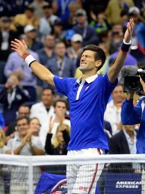 Novak Djokovic of Serbia celebrates after beating Roger Federer of Switzerland in the men's singles final on day fourteen of the 2015 U.S. Open tennis tournament at USTA Billie Jean King National Tennis Center.