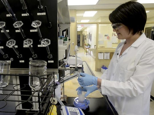 Lab Supervisor Brenna Cook tests the pH of a water sample April 15 at the North Fork Water Treatment Facility.
