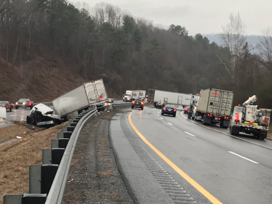 A jack-knifed tractor-trailer closed  I-40 West at