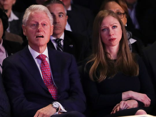 Former President Bill Clinton and Chelsea Clinton, daughter of Hillary Clinton listen during the presidential debate between Republican presidential nominee Donald Trump and Democratic presidential nominee Hillary Clinton at Hofstra University in Hempstead, N.Y., Monday. Chelsea Clinton will campaign on behalf of her mother in Asheville Wednesday.