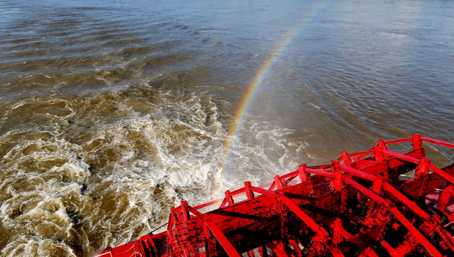 A rainbow appears in the spray from the paddle wheel as the American Queen steamboat makes it's way down the Mississippi River. The six-deck, 418-foot-long steamboat is the largest navigating American Rivers.
