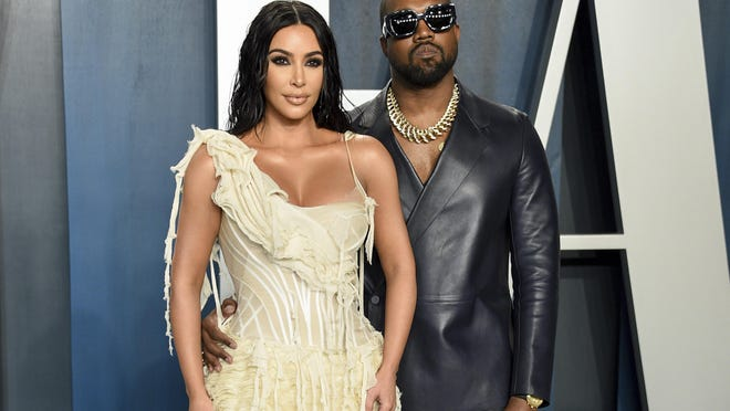 FILE -Kim Kardashian West, left, and Kanye West arrive at the Vanity Fair Oscar Party in Beverly Hills, Calif. on Feb. 9, 2020. Kardashian West is asking the public to show compassion and empathy to husband Kanye West, who she says is bipolar and caused a stir this week after fulminating in a series of social media posts. The reality TV star posted a lengthy message Wednesday on her Instagram Live feed, explaining that life has been complicated for her family and West, who ranted against historical figure Harriet Tubman and discussed abortion on Sunday while he declared himself a presidential candidate.