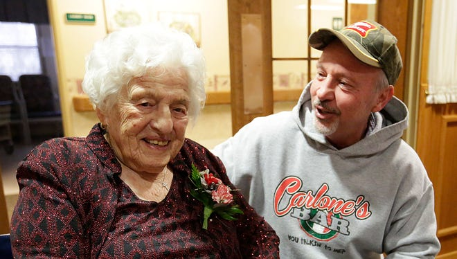 Jean Romalia, who is 107, talks to her nephew Mike Carlone of Fond du Lac during a birthday celebration for her this month.
